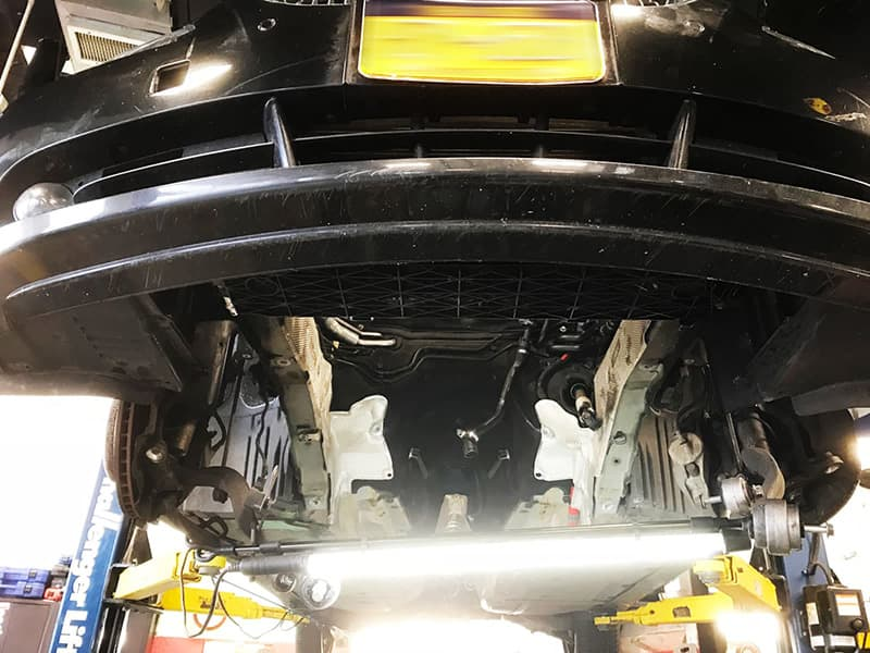 Undercarriage on a lift at Bimmer Motors Group INC.
